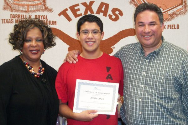 UT Hook em Kid with dad and certificate